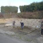 Sciage de la planche béton à laver et nettoyage des bassins